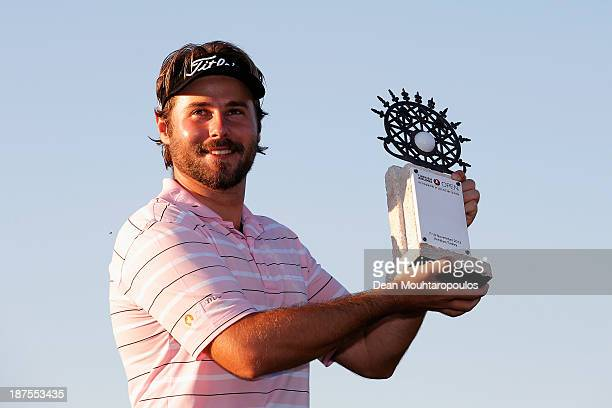 Victor Dubuisson of France poses with the trophy after winning the Turkish Airlines Open at The Montgomerie Maxx Royal Course on November 10 2013 in...