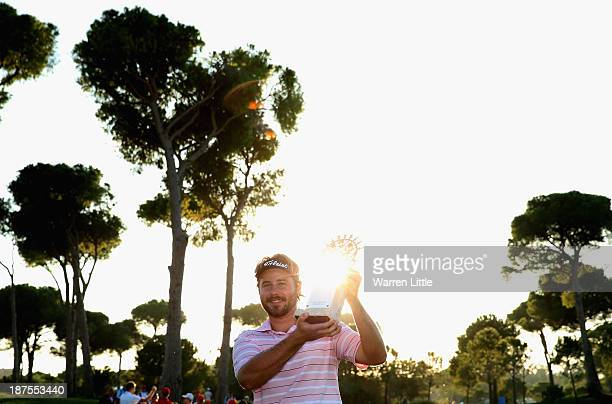 Victor Dubuisson of France poses with throphy after winning the 2013 Turkish Airlines Open on the Montgomerie Maxx Royal Course on a score 24 under...