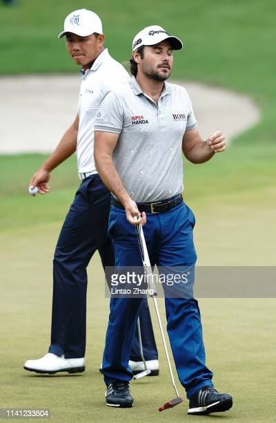 Victor Dubuisson of France reacts after playing a shot during the final round of the 2019 Volvo China Open at Genzon Golf Club on May 5, 2019 in...
