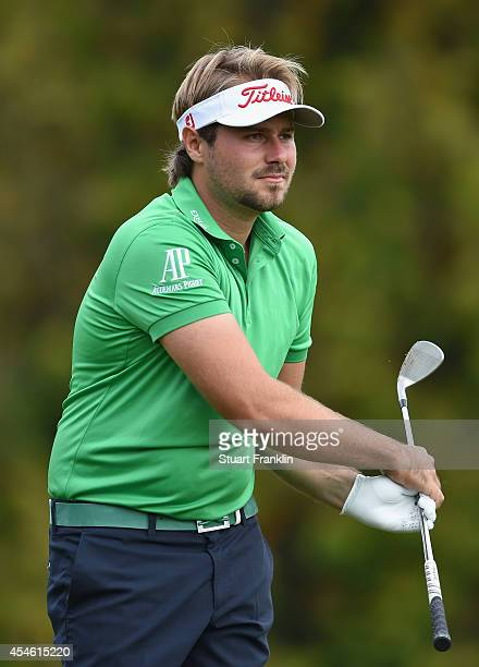 Victor Dubuisson of France reacts to a shot during the first round of the Omega European Masters at CranssurSierre Golf Club on September 4 2014 in...