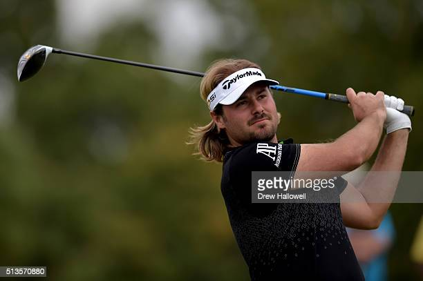 Victor Dubuisson of France tees off on the 18th hole during the first round of the World Golf ChampionshipsCadillac Championship at Trump National...