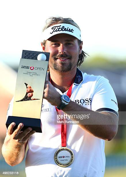 Victor Dubuisson of France winner of the 2015 Turkish Airlines Open with the trophy on the 18th green during the final round of the Turkish Airlines...