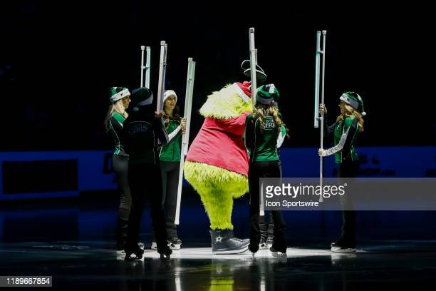Victor E Green skates with the Dallas Stars Ice Girls before the game between the Dallas Stars and the Vegas Golden Knights on December 13 2019 at...
