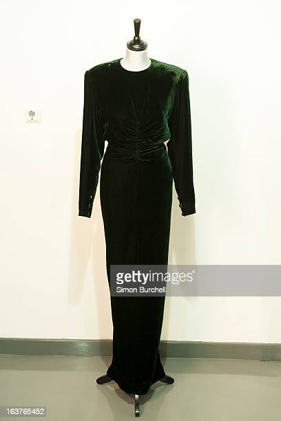 Victor Edelstein bottle green velvet evening gown is displayed at a photocall ahead of the the 'Fit For a Princess' auction on March 15 2013 in...
