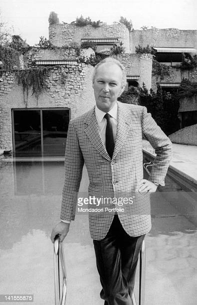 Victor Emmanuel Prince of Naples Crown Prince of Italy on the edge of his swimming pool in his villa Geneva 1982