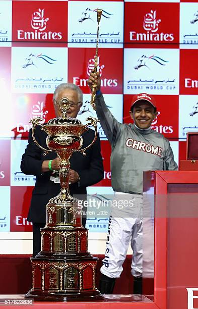 Victor Espinoza celebrates after riding California Chrome to victory in the Dubai World Cup Sponsored By Emirates Airline as part of the Dubai World...