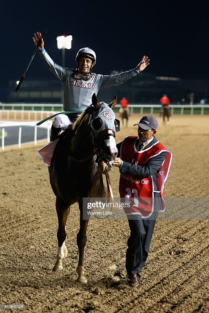Victor Espinoza celebrates riding California Chrome to victory in the Dubai World Cup Sponsored By Emirates Airline as part of the duirng the Dubai World Cup at the Meydan Racecourse on March 26, 2016 in Dubai, United Arab Emirates.