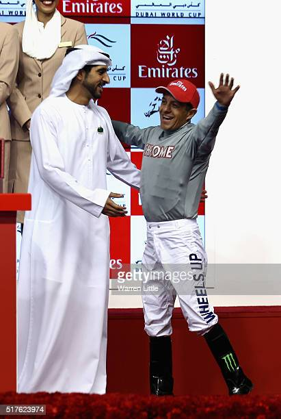 Victor Espinoza is embraced by Sheikh Hamdan bin Mohammed bin Rashid Al Maktoum after riding California Chrome to victory in the Dubai World Cup...