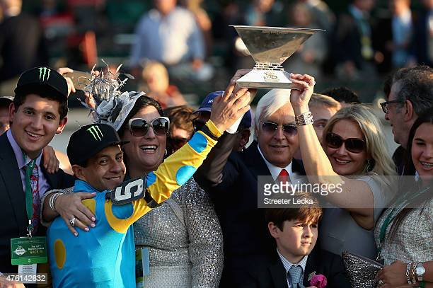 Victor Espinoza , jockey of American Pharaoh, and trainer Bob Baffert, celebrate with the Triple Crown Trophy after winning the 147th running of the...