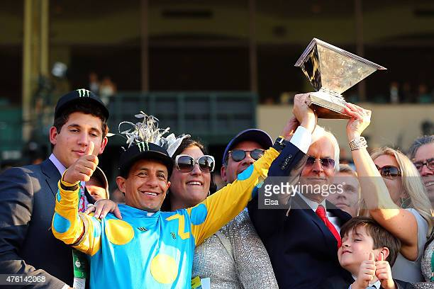 Victor Espinoza , jockey of American Pharoah, and trainer Bob Baffert, celebrate with the Triple Crown Trophy after winning the 147th running of the...
