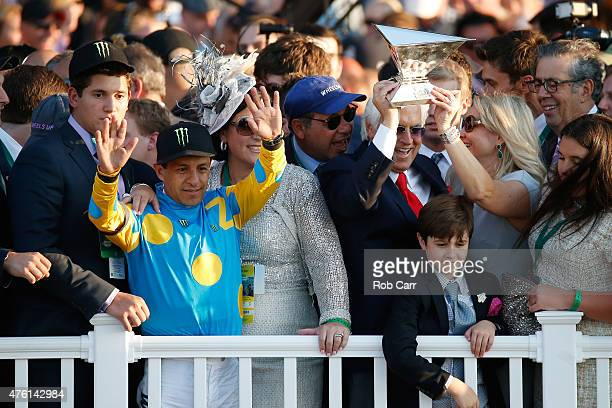 Victor Espinoza jockey of American Pharoah owner of Ahmed Zayat and trainer Bob Baffert celebrate with the Triple Crown Trophy after winning the...
