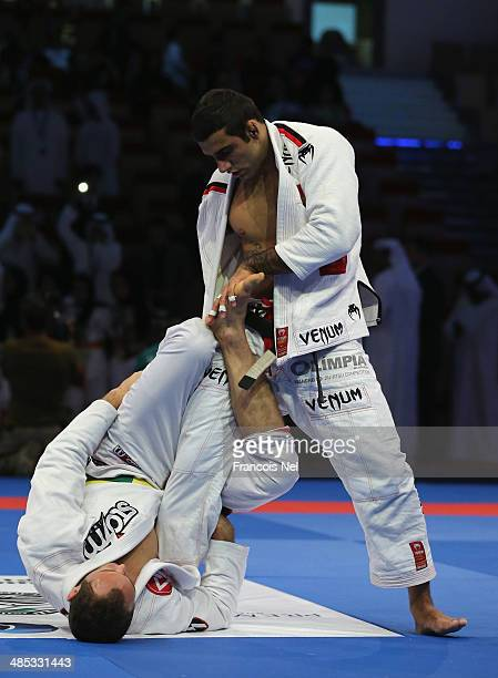 Victor Estima of Brazil competes with Leandro Lo of Brazil in the Men's black belt 82kg finals during the Abu Dhabi World Professional JiuJitsu...