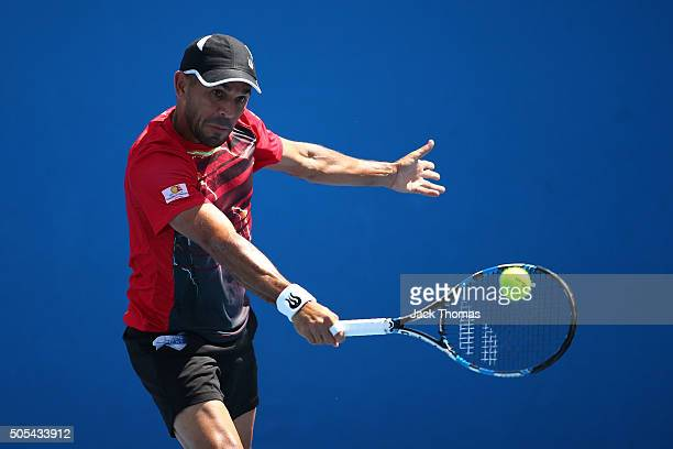 Victor Estrella Burgos of Dominican Republic plays a backhand in his first round match against Daniel Brands of Germany during day one of the 2016...