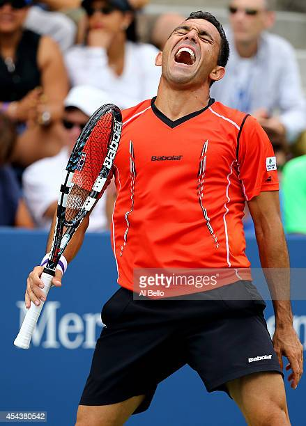 Victor Estrella Burgos of the Dominican Republic reacts against Milos Raonic of Canada during their men's singles third round match on Day Six of the...