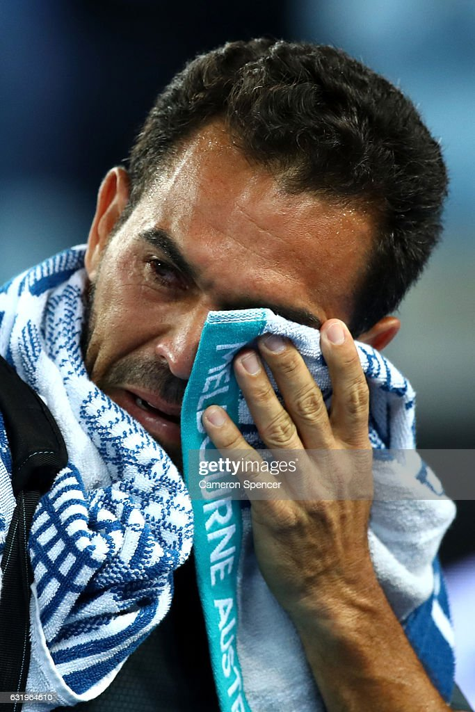 Victor Estrella Burgos of The Dominican Republic shows his emotion after losing his second round match against Bernard Tomic of Australia on day three of the 2017 Australian Open at Melbourne Park on January 18, 2017 in Melbourne, Australia.