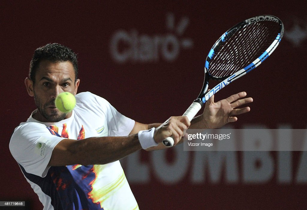 Victor Estrella of Dominican Republic takes a backhand shot during a match between Yuchi Sugita of Japan and Victor Estrella of Dominican Republic as part of Claro Open Colombia 2015 at Centro de Alto Rendimiento on July 23, 2015 in Bogota, Colombia.