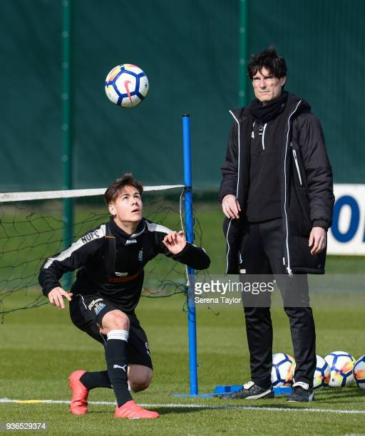 Victor Fernandez heads the ball whilst playing head tennis during the Newcastle United Training session at the Newcastle United Training Centre on...