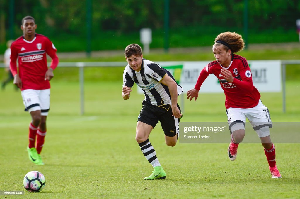 Victor Fernandez of Newcastle (11) and Marlon Fossey of Fulham (2) run to the ball during the Premier League 2 Match between Newcastle United and Fulham at Whitley Park on April 10, 2017 in Newcastle upon Tyne, England.