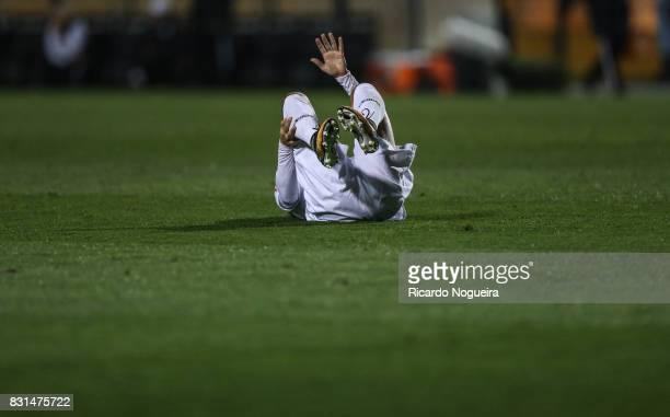 Victor Ferraz of Santos goes down injured during the match between Santos and Fluminense as a part of Campeonato Brasileiro 2017 at Pacaembu Stadium...