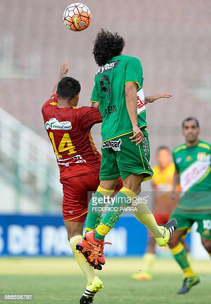 Victor Ferreira of Peru's Sport Huancayo vies for ball with Edgar Mendoza of Venezuelas Deportivo Anzoategui during their Copa Sudamericana 2016...
