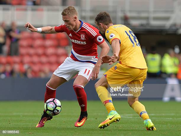 Victor Fischer of Middlesbrough is tackled by James McArthur of Crystal Palace during the Premier League match between Middlesbrough FC and Crystal...