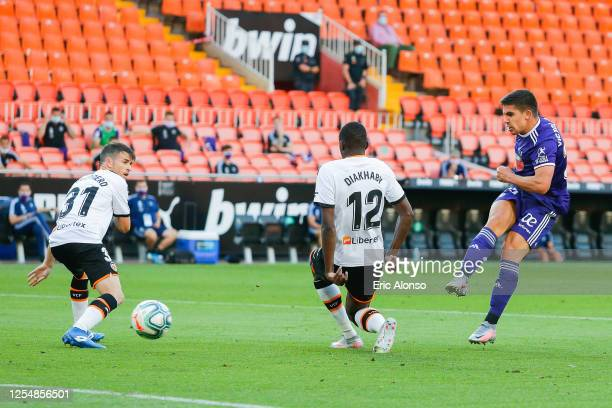 Victor Garcia of Real Valladolid CF scores his team's first goal during the Liga match between Valencia CF and Real Valladolid CF at Estadio Mestalla...