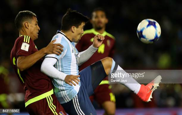 Victor Garcia of Venezuela fights for the ball with Marcos Acuña of Argentina during a match between Argentina and Venezuela as part of FIFA 2018...