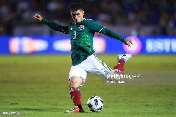 Victor Guzman of Mexico drives the ball during the international friendly match between Mexico and Costa Rica at Universitario Stadium on October 11...