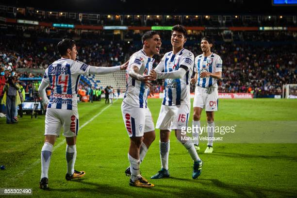 Victor Guzman of Pachuca celebrates with teammates after scoring his team's third goal during the 11th round match between Pachuca and Cruz Azul as...