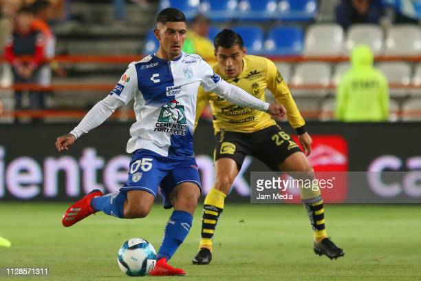 Victor Guzman of Pachuca fights for the ball with Aldo Rocha of Morelia during the 6th round match between Pachuca and Morelia as part of the Torneo...