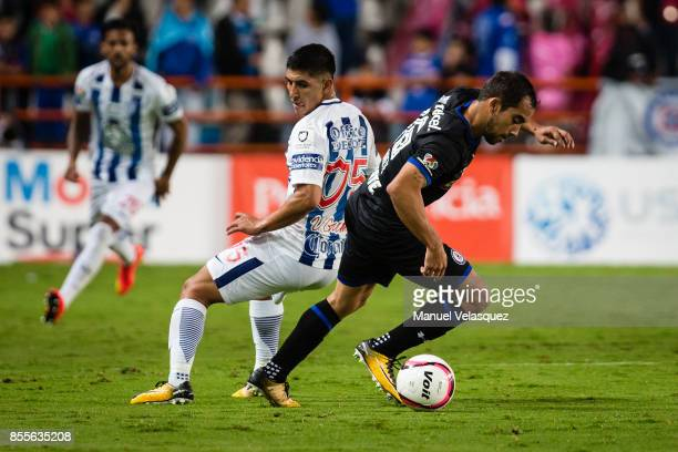 Victor Guzman of Pachuca struggles for the ball with Adrian Aldrete of Cruz Azul during the 11th round match between Pachuca and Cruz Azul as part of...