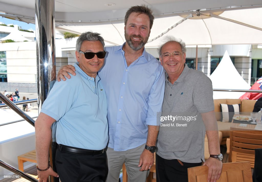 Victor Hadida, Basil Iwanyk and Samuel Hadida attend a lunch hosted by Lexus for The Weinstein Company's 'Wind River' stars and director on May 20, 2017 in Cannes, France.