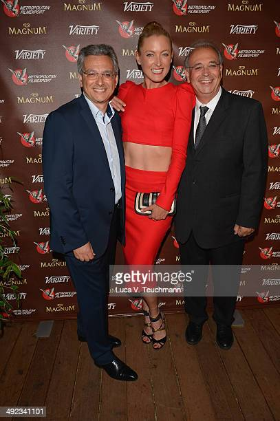 Victor Hadida Lilly zu Sayn Wittgenstein and Samuel Hadida attend the Metropolitan Filmexport 35th Anniversary Party at Magnum Beach on May 19 2014...