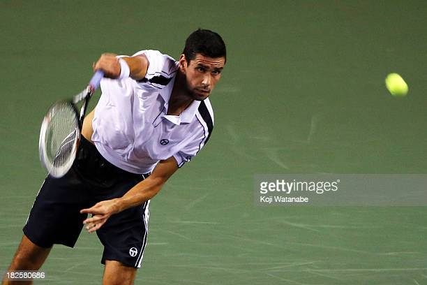 Victor Hanescu of Romania in action during his men's first round match against Janko Tipsarevic of Serbia during day two of the Rakuten Open at...