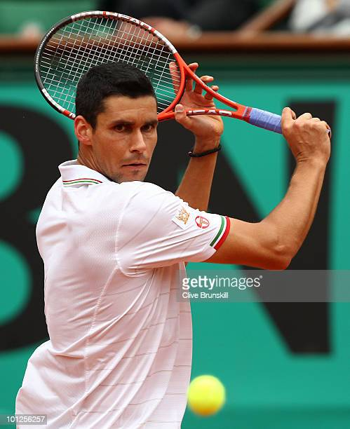 Victor Hanescu of Romania plays a backhand during the men's singles third round match between Novak Djokovic of Serbia and Victor Hanescu of Romania...