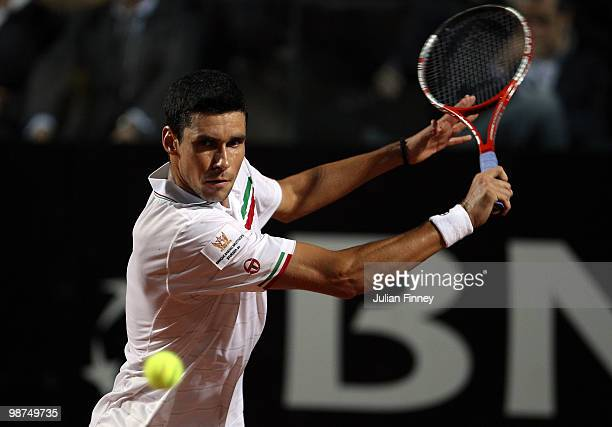 Victor Hanescu of Romania plays a backhand in his match against Rafael Nadal of Spain during day five of the ATP Masters Series Rome at the Foro...