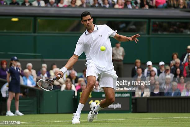 Victor Hanescu of Romania plays a forehand during his gentlemen's singles first round match against Roger Federer of Switzerland on day one of the...
