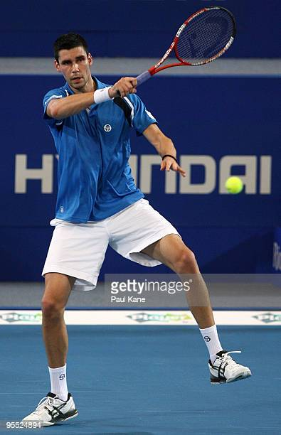 Victor Hanescu of Romania plays a forehand in his match against Lleyton Hewitt of Australia in the Group A match between Australia and Romania during...