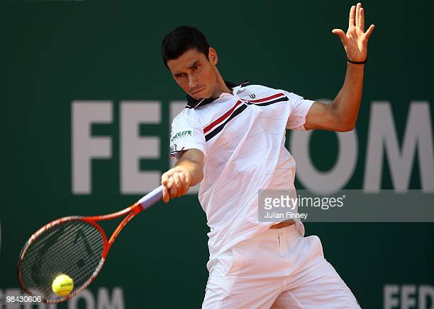 Victor Hanescu of Romania plays a forehand in his match against Stanislas Wawrinka of Switzerland during day two of the ATP Masters Series at the...