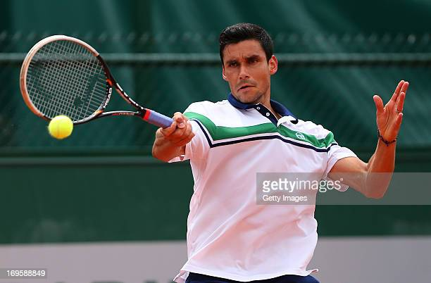 Victor Hanescu of Romania plays a forehand in his Men's Singles match against Bernard Tomic of Australia during day three of the French Open at...