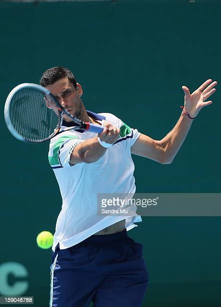 Victor Hanescu of Romania plays a forehand in his qualifying match against Greg Jones of Australia during day one of the Heineken Open at ASB Tennis...