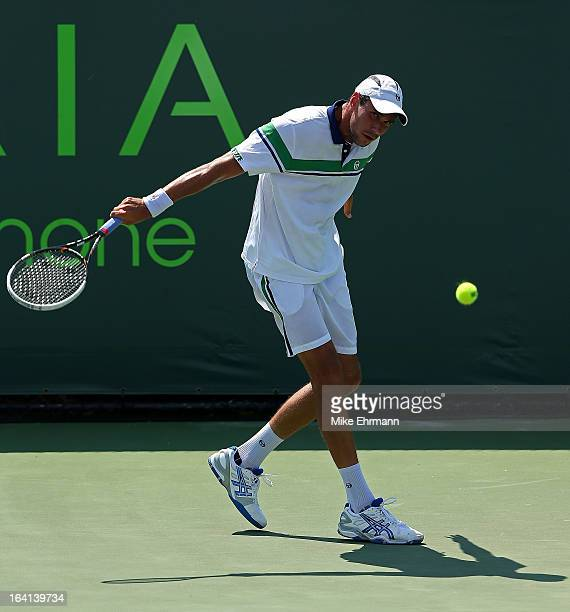 Victor Hanescu of Romania plays a match against Andrey Kuznetsov of Russia during Day 3 of the Sony Open at Crandon Park Tennis Center on March 20...
