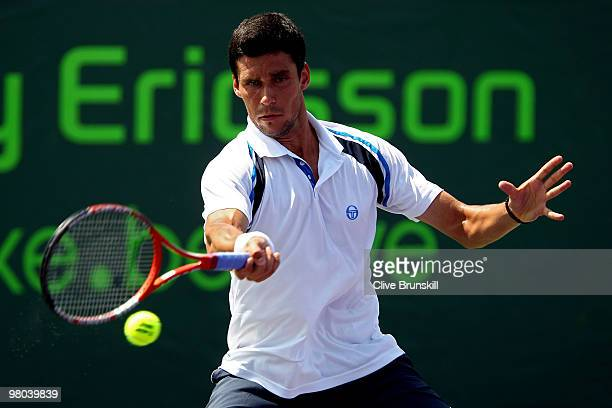 Victor Hanescu of Romania returns a shot against Alejandro Falla of Columbia during day three of the 2010 Sony Ericsson Open at Crandon Park Tennis...