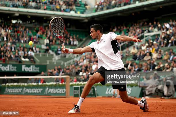 Victor Hanescu of Romania returns a shot during his men's singles match against Gael Monfils of France on day three of the French Open at Roland...