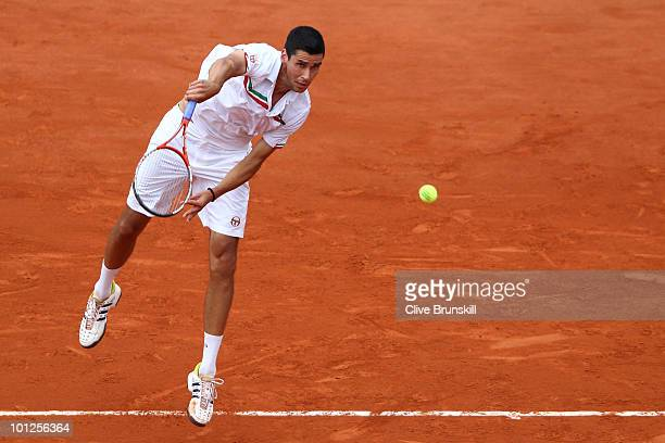 Victor Hanescu of Romania serves during the men's singles third round match between Novak Djokovic of Serbia and Victor Hanescu of Romania at the...