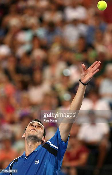 Victor Hanescu of Romania serves in his match against Lleyton Hewitt of Australia in the Group A match between Australia and Romania during day one...