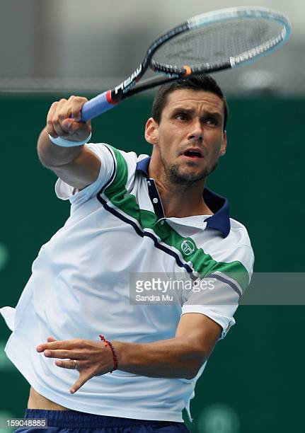 Victor Hanescu of Romania serves in his qualifying match against Greg Jones of Australia during day one of the Heineken Open at ASB Tennis Centre on...