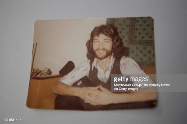 Victor Hayes a survivor of the East Area Rapist places a picture of his younger self on a table during an interview in Carmichael Calif on Thursday...