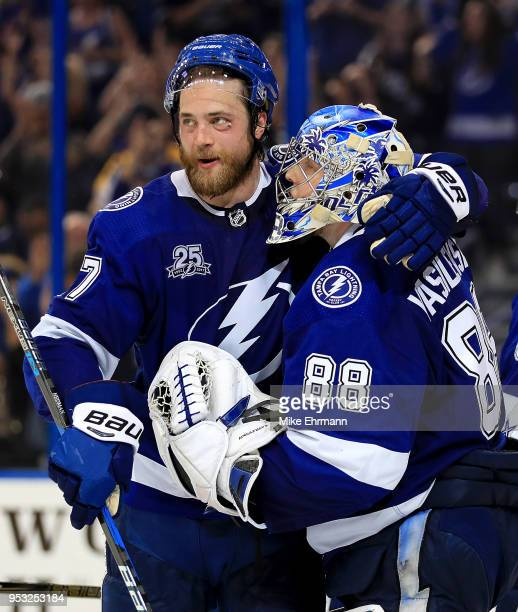 Victor Hedman and Andrei Vasilevskiy of the Tampa Bay Lightning celebrate winning Game Two of the Eastern Conference Second Round against the Boston...