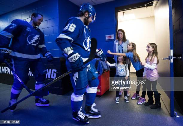 Victor Hedman and Nikita Kucherov of the Tampa Bay Lightning is greeted by fans as he walks to the ice against the Ottawa Senators during the pregame...